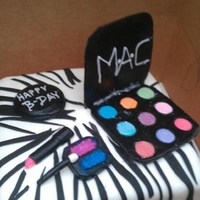 Mac Cake zebra print with a pink bow. MAC make up