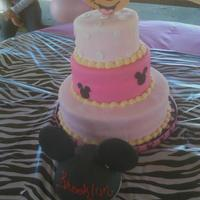 Minnie Mouse Micky Mouse Ears three tier pink Minnie Mouse cake. Chocolate, strawberry and vanilla cake covered in fondant . Mickey ears smash cake