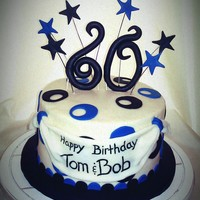 "Blue And Black 60Th Birthday Cake An 8"" carrot cake with cream cheese icing. Fondant decorations."