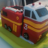 Firetruck Birthday Cake For a friend's sons' third birthday. Took inspiration from a few cakes on cakecentral. This is the third of three cakes I made...