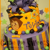 Halloween Dora Cake 6 & 10 inch rounds frosted & filled with buttercream w/fondant decorations.