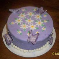 Butterfly Birthday Cake This is a vanilla butter pound cake I got the recipe off of CC. Its filled with blackberry preserves. Covered in MMF lavendar fondant w/...