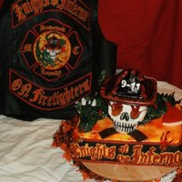 Firefighter Motorcycle Club Cake The knights of the inferno is a biker club for firefighters. The cake is a 3D design of their patch. The dragon is RKT