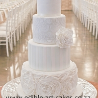 Elegant Mixed 4 Tier Cake Mixture of ruffles, stripes, damask and piping to create a special elegant cake