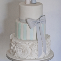 Elegant 3 Tier Cake With Ruffle Bottom And Our Edible Custom Made Toppers Elegant 3 tier cake with Ruffle bottom and our Edible Custom made toppers
