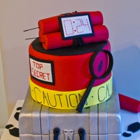 Spy Cake   2tier Chocolate Fudge cake with edible dynamite