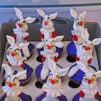 Alice In Wonderland Rabbit Cupcakes   Red velvet cupcakes with gumpaste rabbits!
