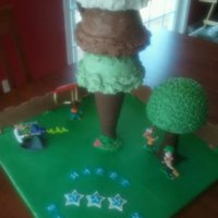 "Phineas & Ferb World's Biggest Ice Cream Cone Cake Inspired by the ice cream cone cakes here on CC. Buttercream ""ice cream"" scoops, cone is styro covered in fondant, fence is..."