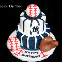 Yankee's Birthday Cake Yankee's Birthday cake. Buttercream icing with fondant details. Balls and glove are rice Krispy treats.