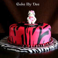 Hello Kitty Zebra Cake Hello Kitty made out of gumpaste and cake covered in Duff fondant.