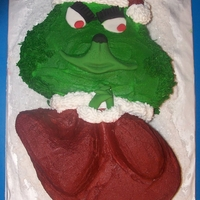 The Grinch This cake I made for my middle grandson for his Christmas party at school. It is buttercream and fondant. Eyes, nose, mouth and hands are...