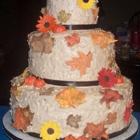 Fall Themed Wedding Cake all edible except ribbon around bottom of tiers. pumpkins, leaves sunflowers all made from gumpaste. First wedding cake I ever made
