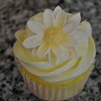 Daisy Cupcaks Leomon cake with lemon cream cheese frosting. Gum paste flowers