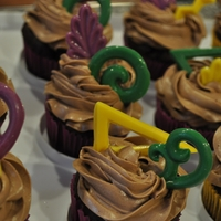 Last Minute Mardi Gras Cupcakes Very last minute so the odd shapes were the closest thing I could throw together. Chocolate, raspberry filling and chocolate swiss meringue...