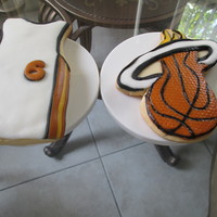 Basketball Vanilla sugar cookies. The logo cookie was hand cut and detail painted with edible colors. I am getting better at it. I am so happy!