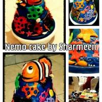 "Nemo Cake For A One Year Old 2 tiered cake bottom cake is an 8"" moist chocolate caketop tier is a 6"" vanilla cakeAll work is fondantNemo is carved n made out..."