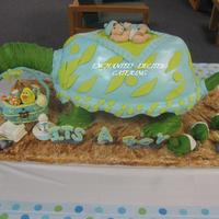 Baby Shower Turtle Cake yellow cake with chocalate bavarian creme. baby on top of turtle and baby turtle as well as all of the elements are made of fondant