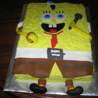 Spongebob yellow cake with buttercream filling and frosting and fondant accents