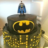 Batman Birthday Cake Eh not the best pics, I know. Buttercream frosted cake with fondant Skyline buildings. Batman candle topper.