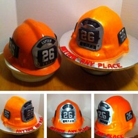 La City Fire Captain Helmet Real Helment on left cake on right