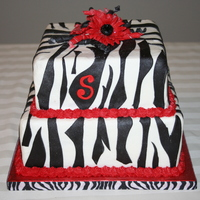 Zebra Graduation Cake   Buttercream with fondant decorations.