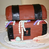 Treasure Chest Cake The top was made using 6inch rounds and the bottom was carved out of sheet cake.Everything was done using fondant.