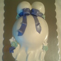 Baby Belly Cake   Covered in fondant with fondant flowers. Used Wilton half ball pan for belly.