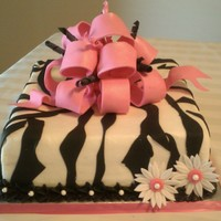Zebra Birthday Cake   Buttercream with fondant zebra stripes and gumpaste bow.