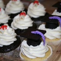 Graduation Cupcakes   Made the caps using reeses candy and fondant. The diplomas were fondant too!