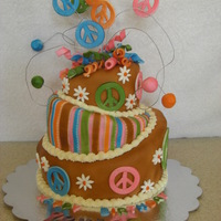 60's Cake Topsy-turvy 60's cake for my daughter's birthday. The colors match her party decorations.