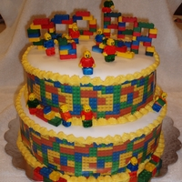 Lego Cake  LEGO cake for my son. The mini figs are gumpaste. The LEGOS are the candy LEGOS that I painted to brighten them up and glued together with...