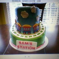 Choo Choo Train white vanilla cake with butterrum buttercream on bottom tier. Chocolate fudge top tier with vanilla buttercream.