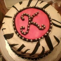 Zebra Cake Chocolate Cake with white ganache filling. Buttercream with fondant accents.