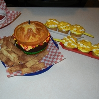 Hamburger Cake With Pie Fries And Corn On The Cob This was my husbands 30th birthday cake. It is a big version of the hamburger cupcakes that I make. Yellow cake for buns and a brownie for...