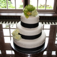 Black, White And Green Cake A simple cake for a good friend's wedding. Bottom tier was chocolate cake with raspberry swiss meringue buttercream, middle tier was...