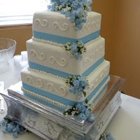 Square Wedding Cake This cake was made for a young bride that I go to church with. She wanted baby blue ribbon and flowers and the square shape.