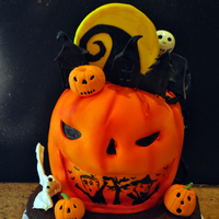 Nightmare Before Christmas Halloween Cake   WASC cake with nutella buttercream, covered in mmf fondant.Gumpaste figures, rice krispies,chocolate nad graham craker base.