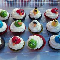 Angry Bird Cupcakes Made for my son. I forgot to take a picture before they sat in the 90 degree weather. :( Angry Birds made out of Airheads and Starbursts.