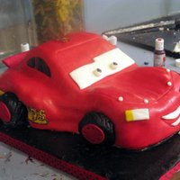 Lightning Mcqueen!  WASC, rainbow, Indydebi buttercream under MMF. Wheels are cupcakes per the instructions. It's not too bad though as always the next...