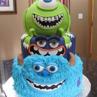 Monsters University all Edible. Sully covered in b/c with rkt eyebrows & fondant accents. mike is all cake covered in fondant w/ fondant accents. middle...
