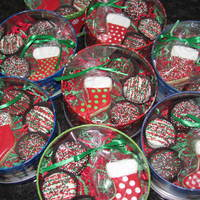Christmas Cookie Tins Stockings all iced with royal icing. Tins filled with chocolate covered oreos as well.