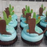 "Cactus And Boots Cupcakes Cactus and boots with a ""tribal boot"" for the special boy."