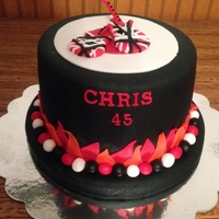 Rock N Roll Birthday Cake This cake is a spice cake with apple pie filling, covered in black vanilla fondant. The EVH guitars on top are a nod to my son's love...