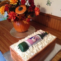 "Wine Bottle Cake In Crate Wine bottle cake. Yellow butter cake with cannoli filling, buttercream crumb coat and fondant panels for the crate, fondant ""tissue&..."