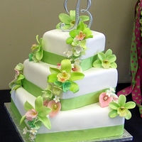 Ashlys Orchids This is a Spring wedding cake with gumpaste cymbidium orchids, calla lilies, hydrangeas, and stephanotis to match the brides bouquet. This...