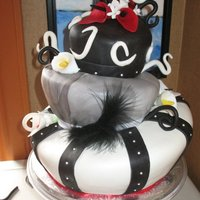 Topsy Turvy Wedding Cake This was a cake requested by my good friend, Her colors were black, white and red and she wanted a topsy turvy funky style cake. This is...