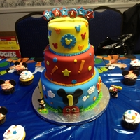 Mickey Mouse Clubhouse 1St Birthday 6, 8, and 10 in cake tiers. covered in fondant with fondant and buttercream accents.