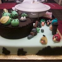 Angry Birds Birthday Cake 9x13 sheet cake with 8 in round. Covered in fondant with all fondant details.