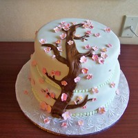Cherry Blossom Birthday Cake 2 tier cake, covered with MMF. cherry blossoms made out of gum paste