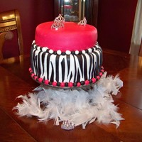 Zebra/pink Princess Cake yellow cake filled with buttercream and raspberry topped with MMF